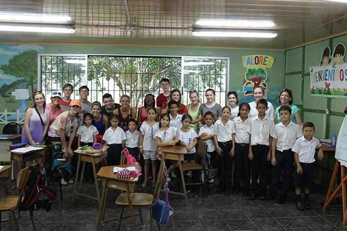 All of the students who went to Costa Rica pose with the students from a school they visited. During the visit, the school girls performed several dances native to Costa Rica.