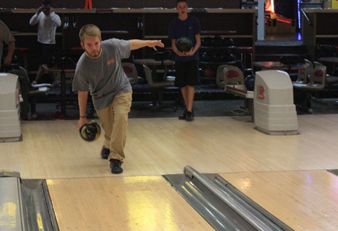 Captain Austin Gray, senior, practices his swing at West County Lanes on Manchester Road. Gray said he has the highest average score on the team, with an average of 180-185.