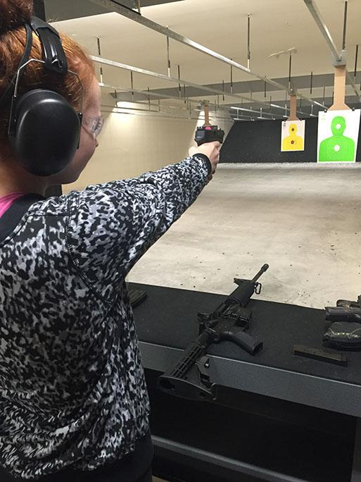 Bailey Stoddard, junior, tries out her stepfathers new gun at The Range St. Louis West on Nov. 28. Its a very secure place, Stoddard said.