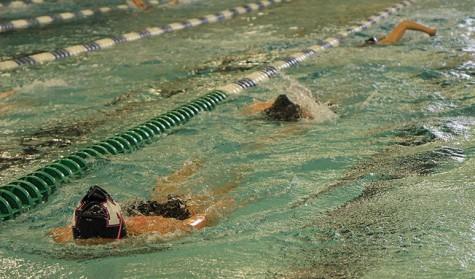 Girls swim captures Conference title