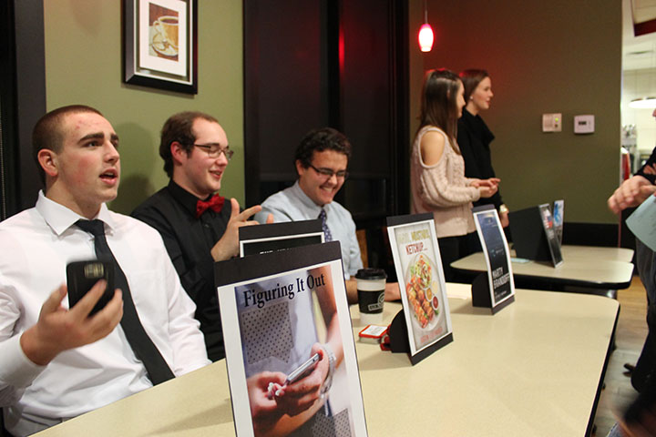 """Seniors Jack Lafferty, Justin Leuthauser and Michael Robinson enjoy time with each other between discussing their short stories with guests. """"The best part about creative writing is that you can freely express yourself with no backfire,"""" Leuthauser said."""