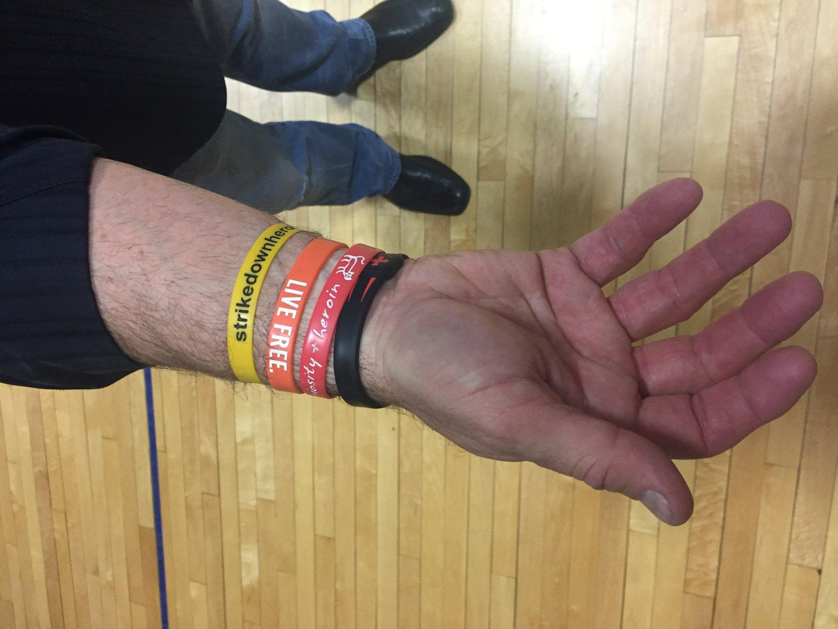 Joe+Richardson%2C+former+Red+Sox+player+and+little+league+coach%2C+displays+his+wristbands%2C+that+represent+the+awaken+project%2C+and+his+own+struggles+with+the+loss+of+his+loved+ones+to+heroin.