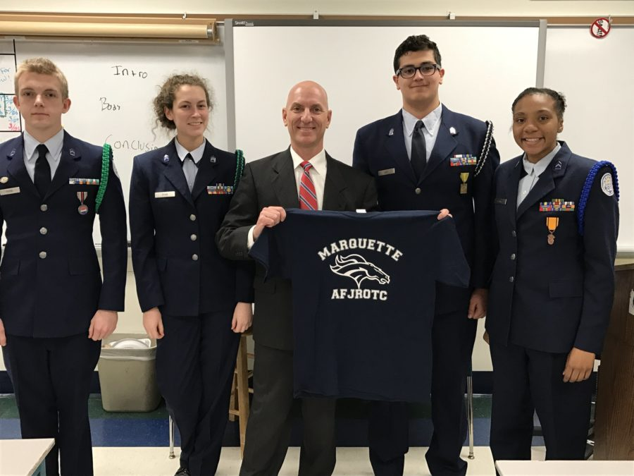 Inspector+%28Col-Ret%29+Todd+Taylor+and+the+Presentation+Team+hold+up+a+MHS+AFJROTC+shirt.