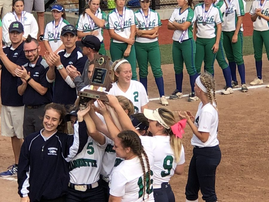 Kelsey+Lenox%2C+Lillie+Knesel%2C+Sydney+Dana%2C+seniors%2C+and+other+members+of+the+varsity+Softball+team+hold+up+the+State+Title+trophy.+MHS+beat+Blue+Springs+South+with+a+score+of+2-0+to+earn+the+title.