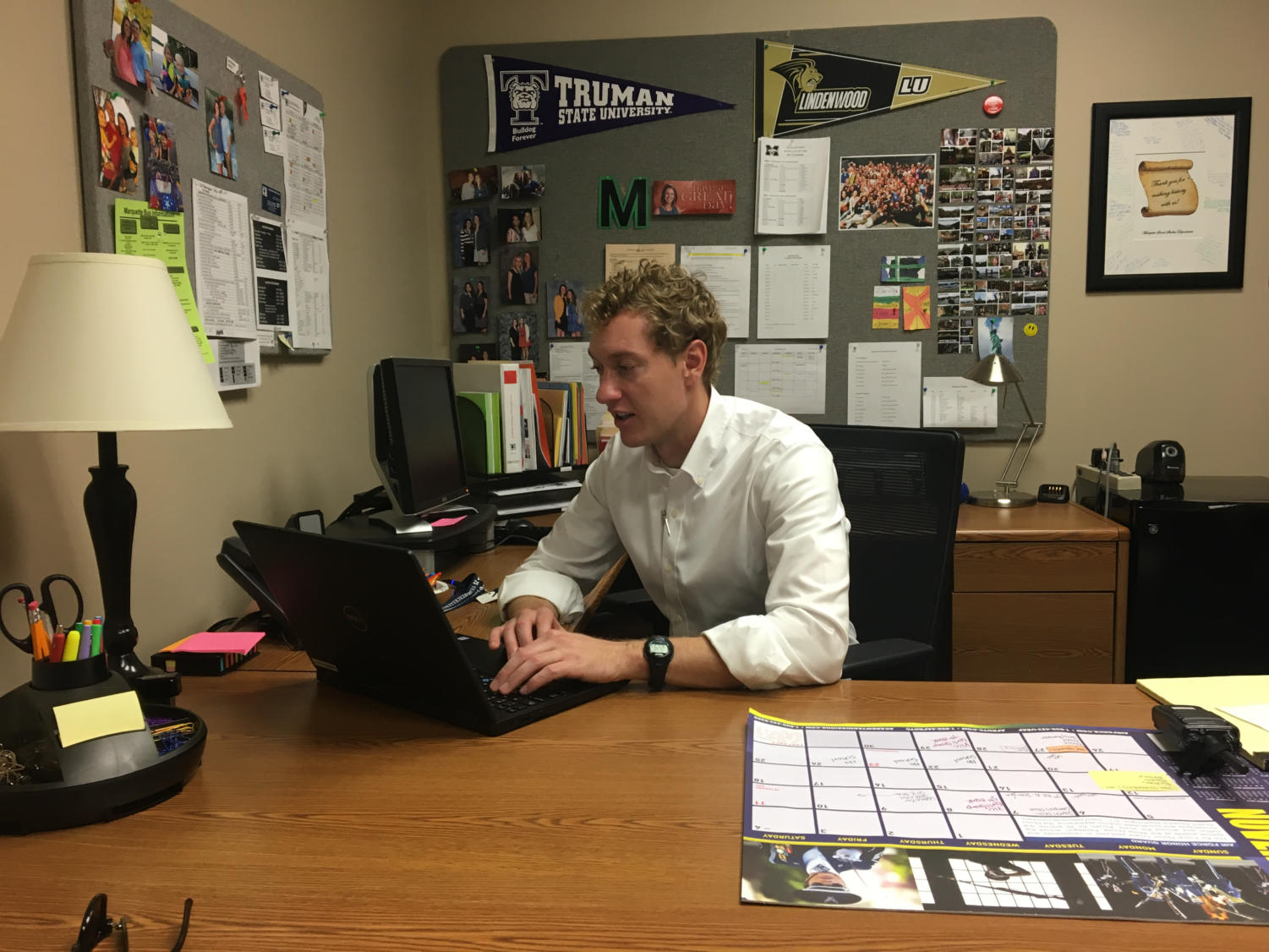 Ryan Bixby, chemistry teacher, sits at his desk in the freshman office. Bixby subbed-in for Tracey Waeckerle, freshman principal.