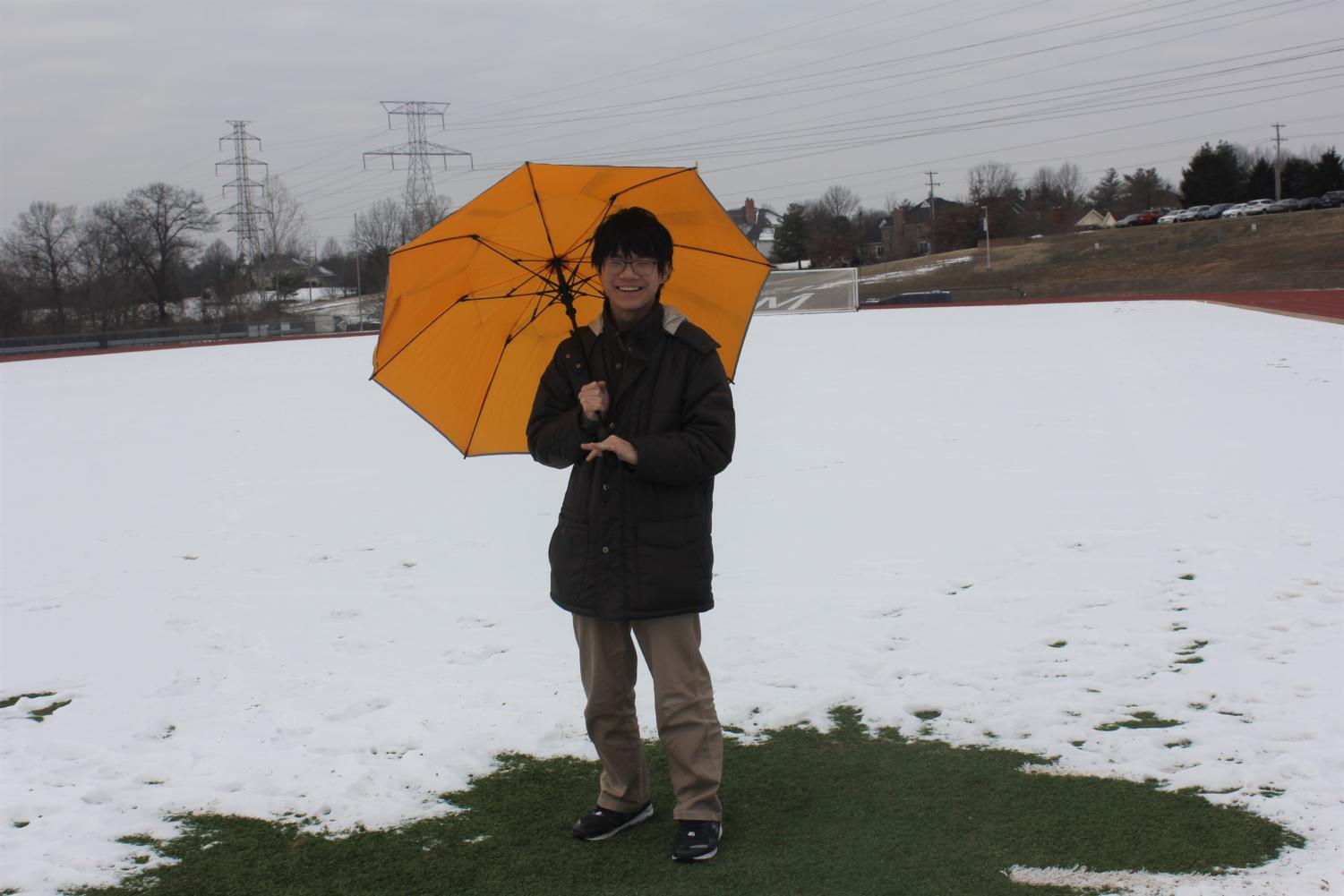 Clay Huang, sophomore, said he carries a yellow umbrella around with him in case it rains or snows.