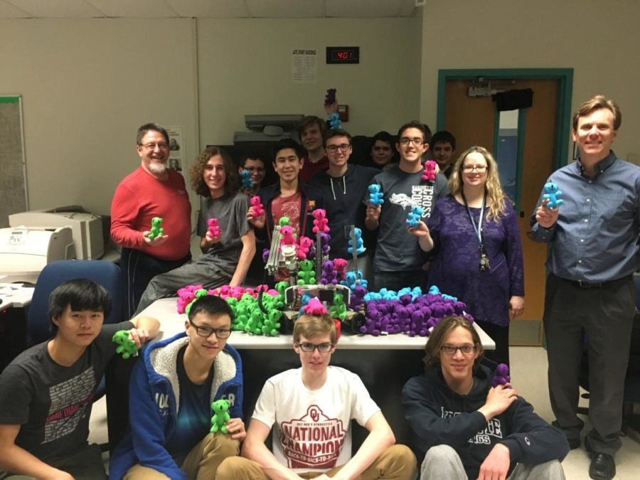 The+Baryons+Robotics+team+poses+with+the+gifts+that+they+plan+to+deliver+to+patients+at+Mercy+Hospital.+The+team+will+be+competing+at+State+this+weekend.