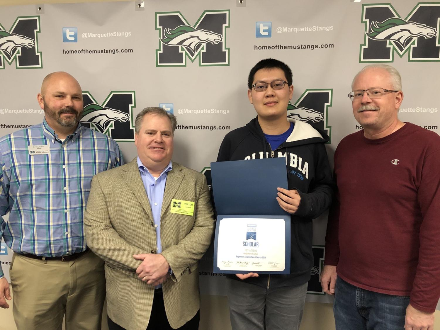 Jerry Zhang, senior, receives the 2018 Regeneron Science Talent Search Scholar Award on March 6. He conducted research to create a computer simulation aimed at removing errors within the physical experiment.