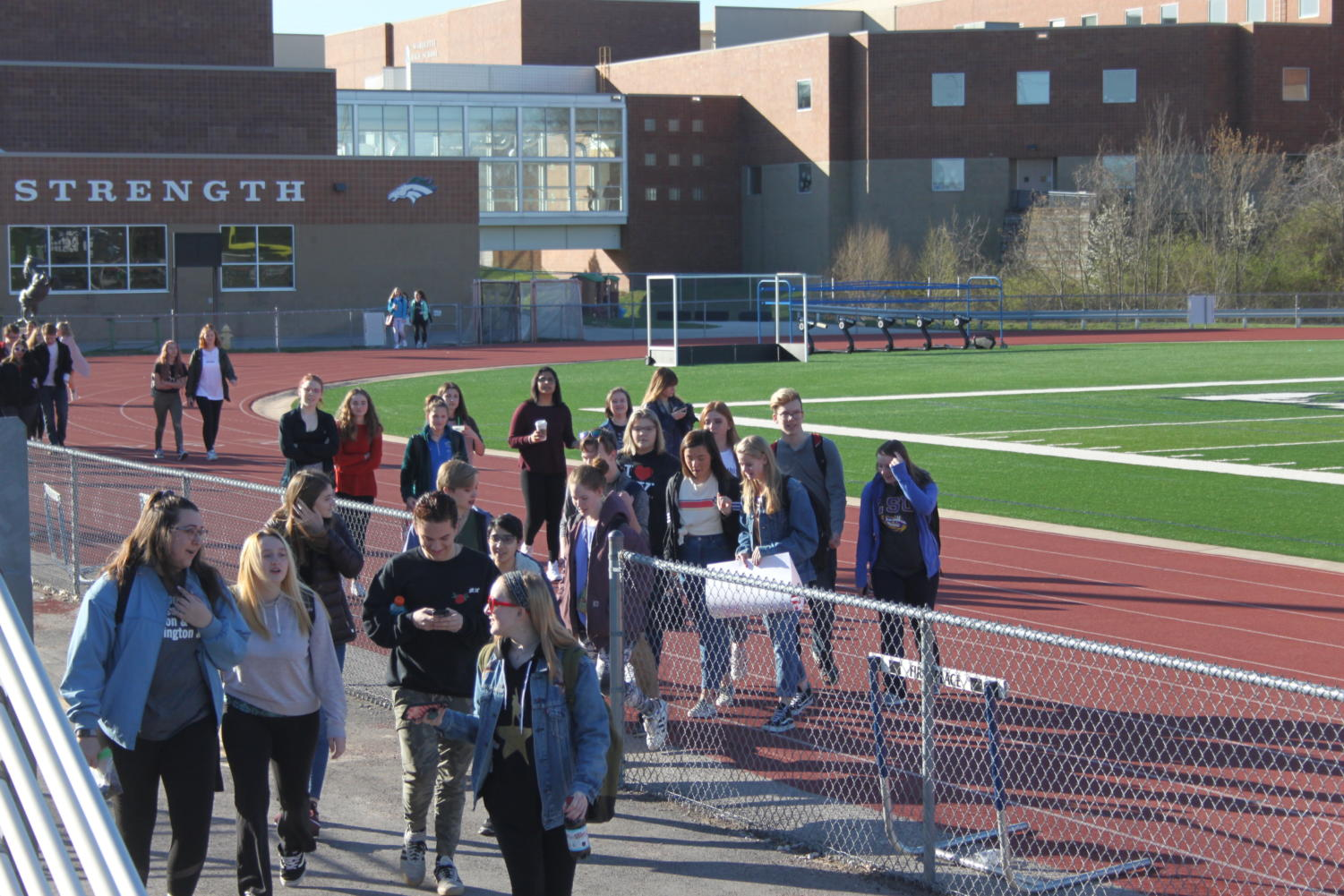 Students+walk+out+of+school+at+8%3A10+a.m.+on+Friday%2C+April+20%2C+which+marks+the+19th+anniversary+of+the+Columbine+shooting.+Students+all+around+the+nation+participated+in+the+Walkout+to+call+for+action+against+gun+violence.
