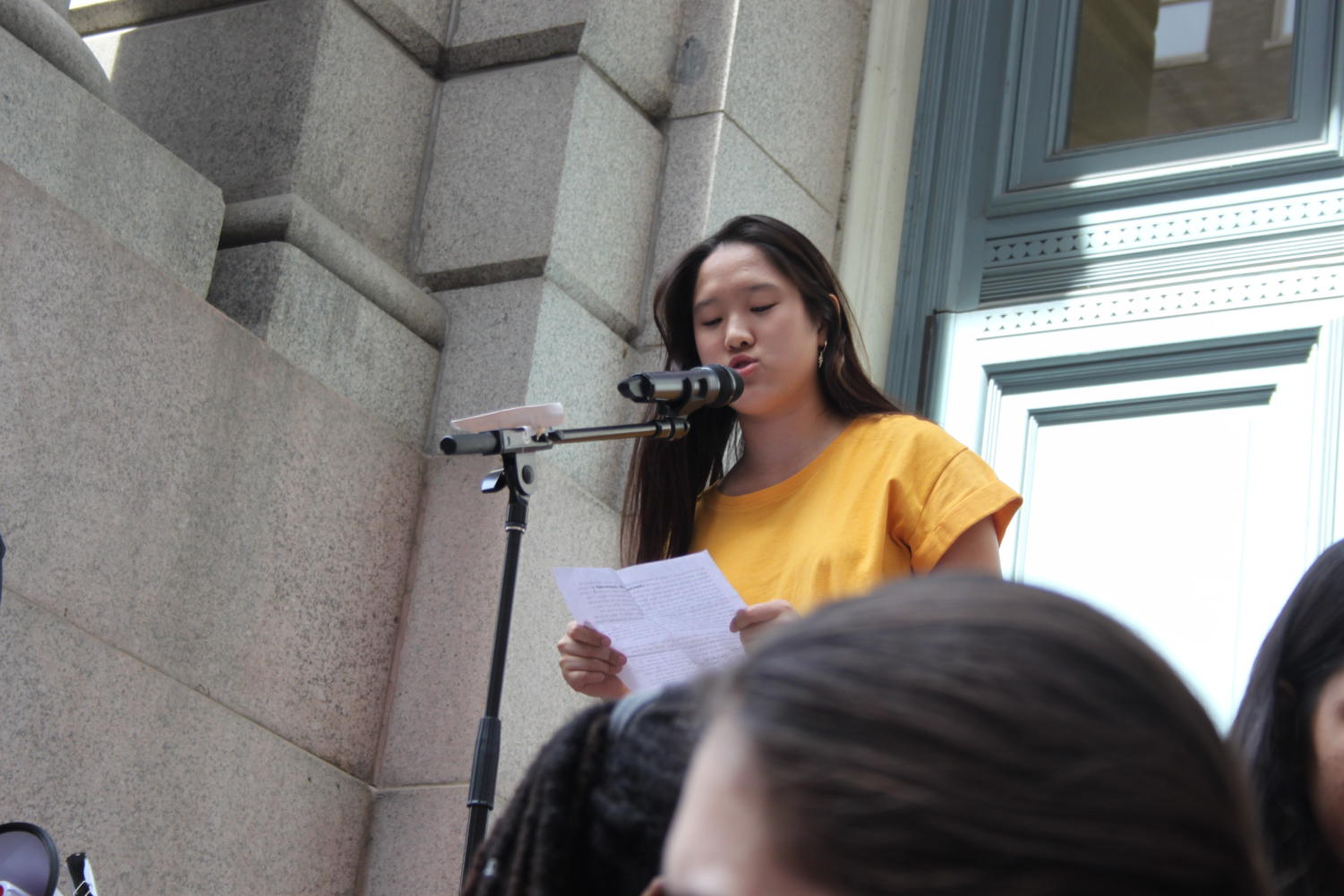 Tiffany+Yoon%2C+junior+at+MHS%2C+speaks+about+gun+violence+and+her+experience+as+an+immigrant.+%E2%80%9CWhen+I+was+writing+my+speech+I+was+trying+to+look+at+gun+violence+as+less+of+a+political+issue+and+more+of+a+humanity+crisis%2C%E2%80%9D+Yoon+said.
