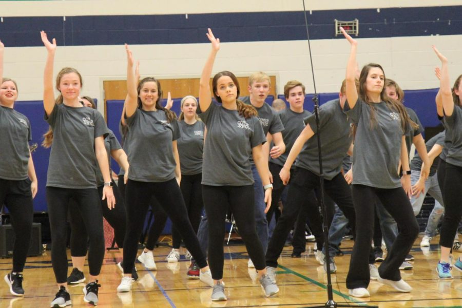 Madison Lakamp, Junior, Shae Schiff-Clark, Senior, Lucy Alexander, Junior, and  Victoria Anderson, Senior, preforming for Center Stage, Marquettes Show Choir.