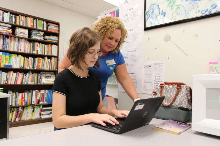 Dr.+Robin+Lady%2C+gifted+resource+teacher%2C+helps+Mia+Kreissler+with+using+her+Chromebook.+Dr.+Lady+and+Judi+Willenbrink+are+the+new+gifted+resource+teachers.