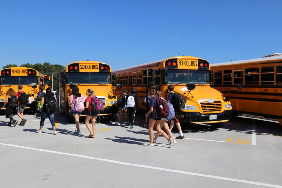 Students gather as they board their buses.