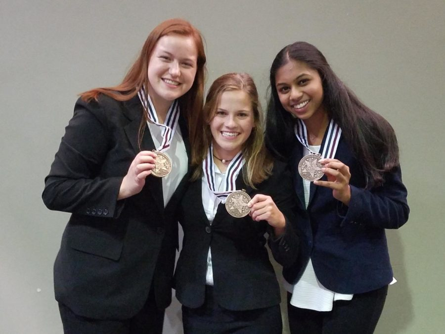 Seniors+Kayla+Berry%2C+Kelley+Sinning+and+Neha+Bollam+%28from+left+to+right%29+stand+backstage+with+their+medals+after+learning+they+placed+third+for+their+Tuberculosis+Tester.