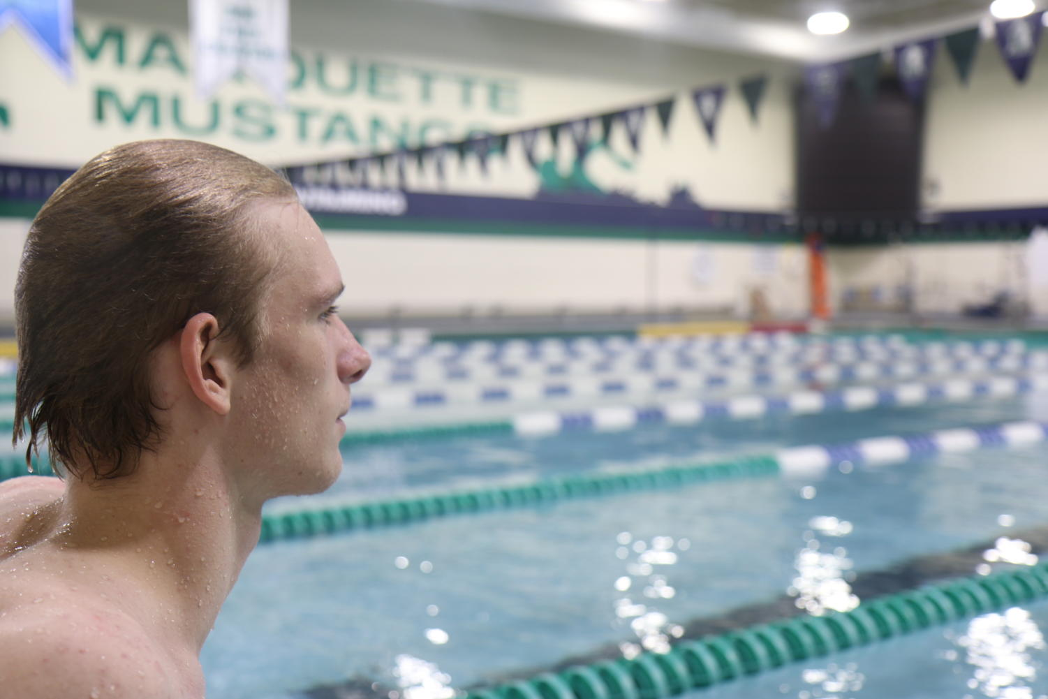 Simon Hermansen, junior, looks at the MHS mustangs pool before their meet on Tuesday against Fort Zummwalt West, where they won.