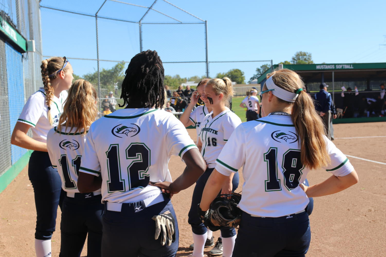 The softball team meets before the start of the Quarterfinals game on Oct. 20 at MHS. The team faced Oakville tigers.