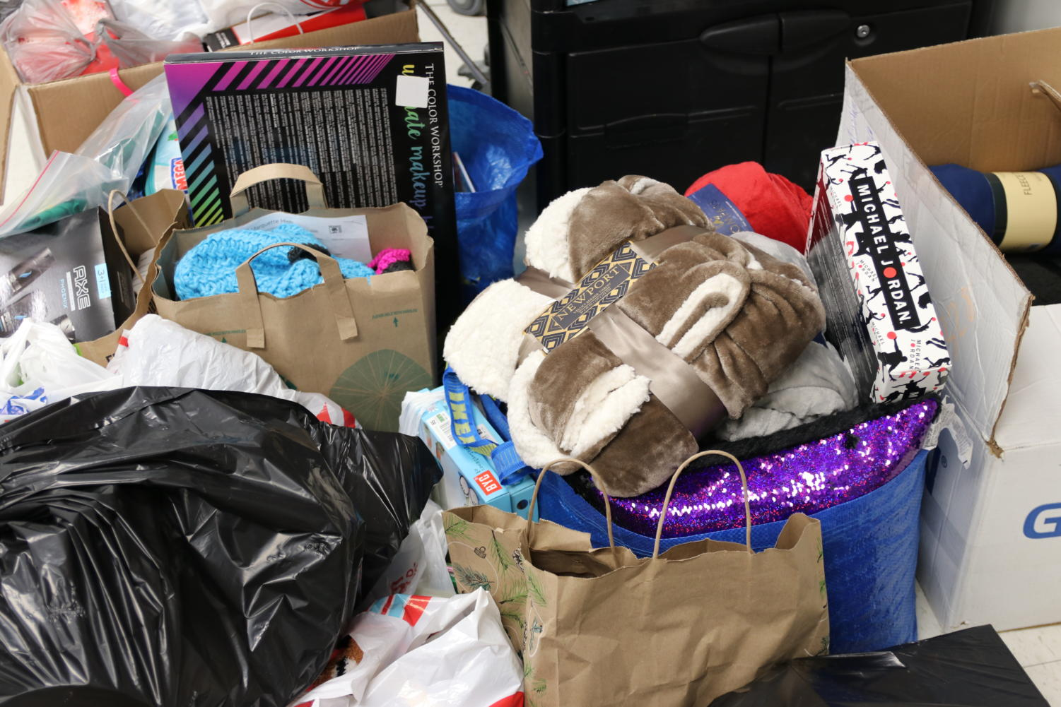Bags and boxes of donated items, like blankets and games, were brought in by students, their families and teachers to be sent to the Jefferson County Foster Care as gifts for their holiday party. Key Club is accepting donations until Friday, Nov. 30 in Rooms 328, 217, 212 and in front of the Library.
