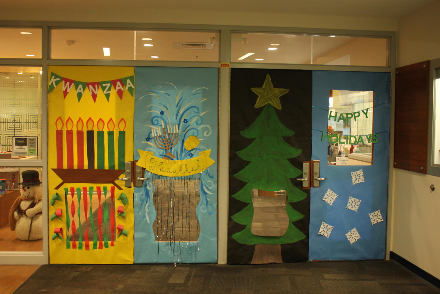 The library doors decorated for winter holidays.
