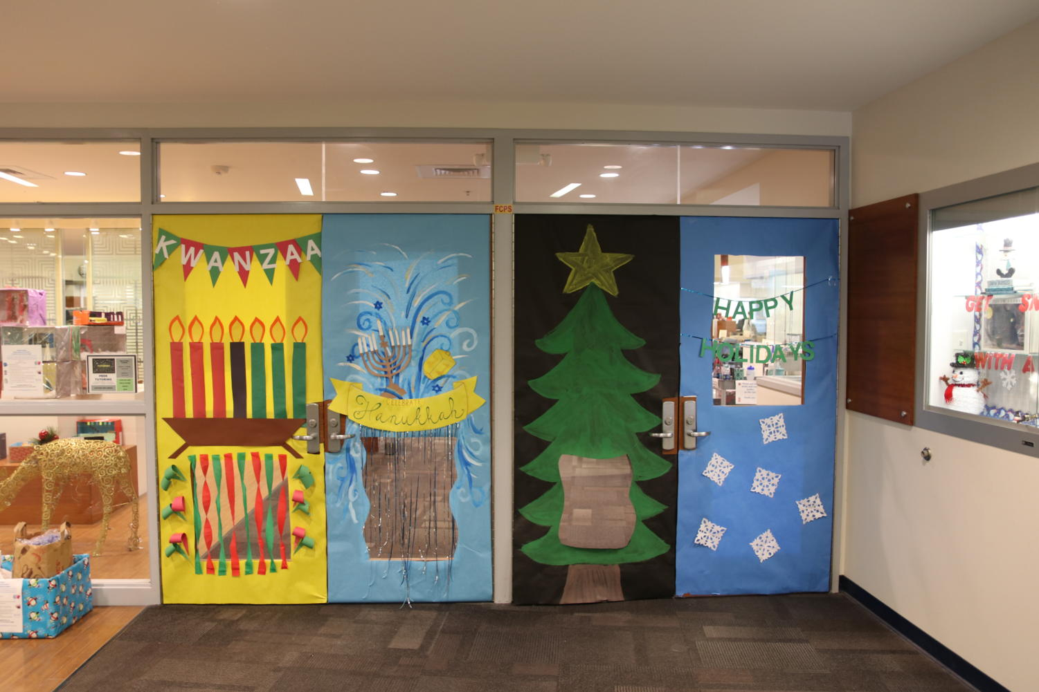 Christmas%2C+Hanukkah+and+Kwanzaa+are+represented+on+the+outside+of+the+Library%E2%80%99s+doors.+There+is+also+an+all-encompassing+winter+themed+door.+