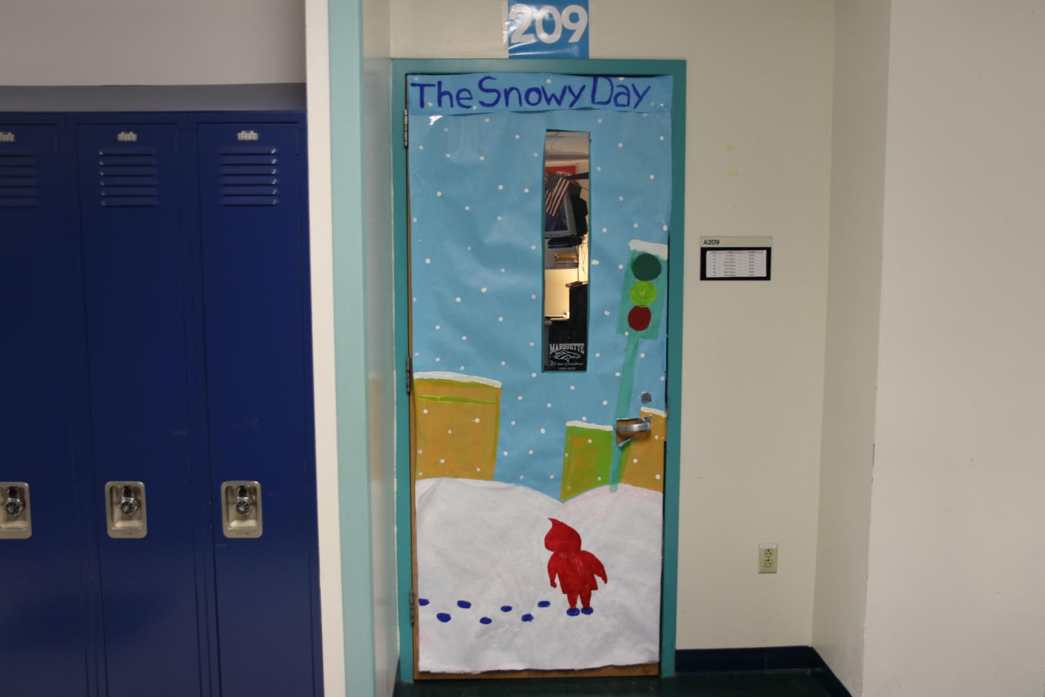Luke+Gentry%2C+social+studies+teacher%2C+had+his+door%2C+Room+209%2C+decorated+based+on+a+classic+book+%E2%80%9CThe+Snowy+Day%E2%80%9D+written+by+Ezra+Jack+Keats.+The+children%E2%80%99s+book%2C+published+in+1962%2C+is+based+on+a+boy+experiencing+his+first+snow+of+the+season.