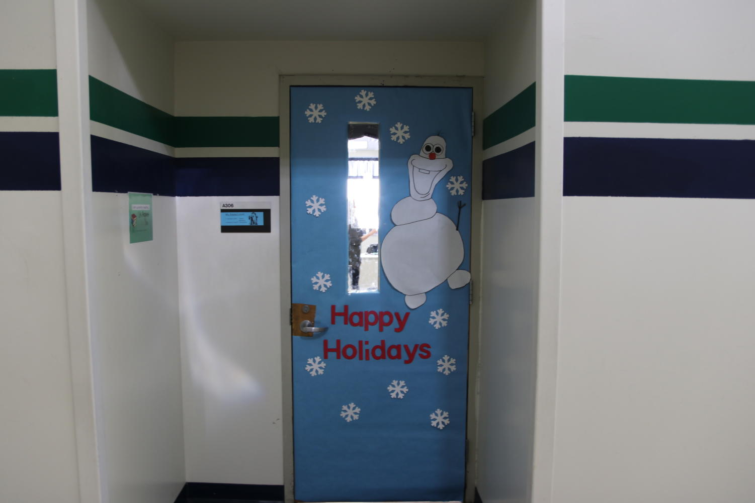 Cathy+Presley%2C+math+teacher%2C+has+a+familiar+character+on+her+door.+The+character%2C+Olaf%2C+from+Disney%E2%80%99s+Frozen+is+bright+and+present+against+the+blue+background.+%0A
