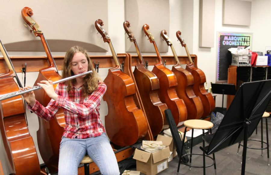 Abby Grace, junior, practicing the flute in symphonic orchestra.