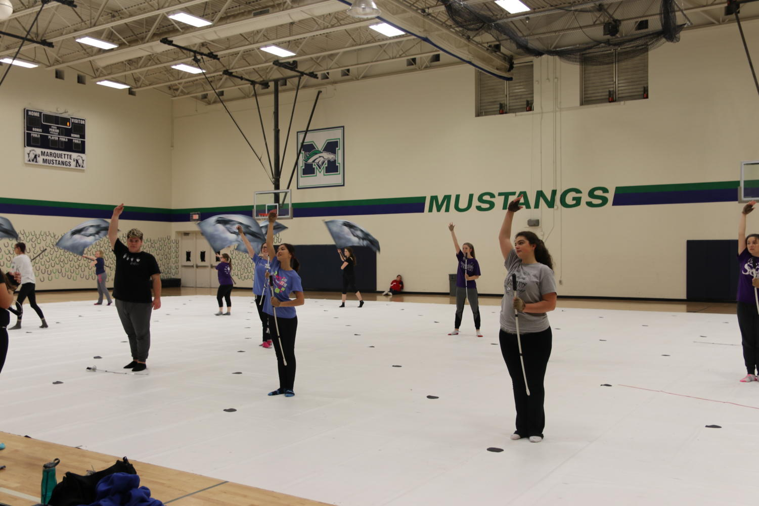 The Winter Guard, directed by Melissa Wilson, art teacher, practices their 2019 show. The show is inspired by pop art.