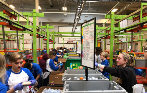 "Working in the Houston Food Bank, students pack bags with water and food for those hurt by Hurricane Harvey. Students spent hours making care packages for those affected by the hurricane. ""The work was long and hard,"" Andrews said. ""But in the end, it was totally worth it."""