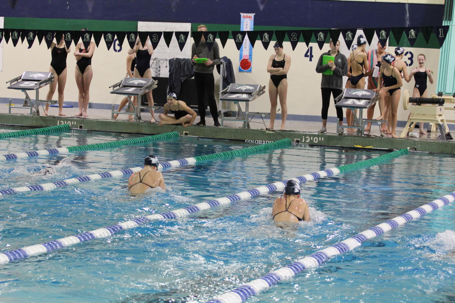 Senior+Allyson+Cochran+and+sophomore+Haley+Hume+swim+side+by+side.+Usually+team+members+are+not+allowed+to+swim+in+adjacent+lanes%2C+but+coaches+can+request+a+%E2%80%9CJV+heat%E2%80%9D+where+team+members+can+swim+just+for+time+and+are+not+recorded+for+heat.+%0A