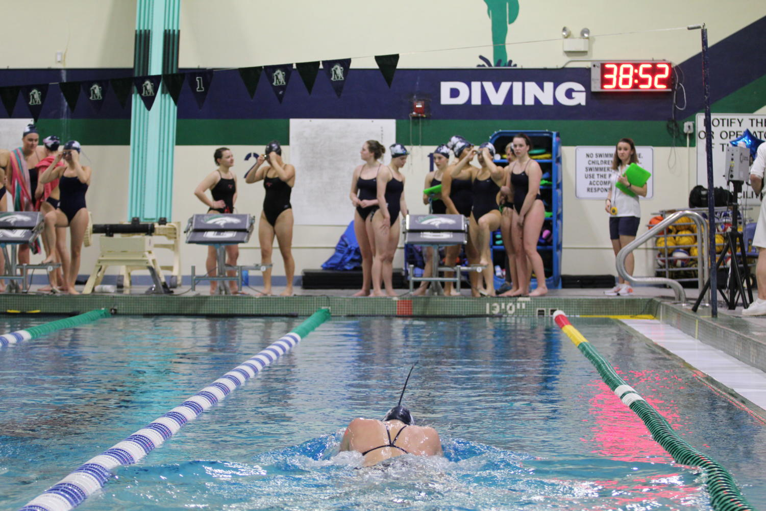 Sarah+Rosson%2C+senior%2C+swims+in+a+100-meter+breast+event.+Rosson+has+been+on+the+team+for+all+four+years+of+her+high+school+career.+%0A