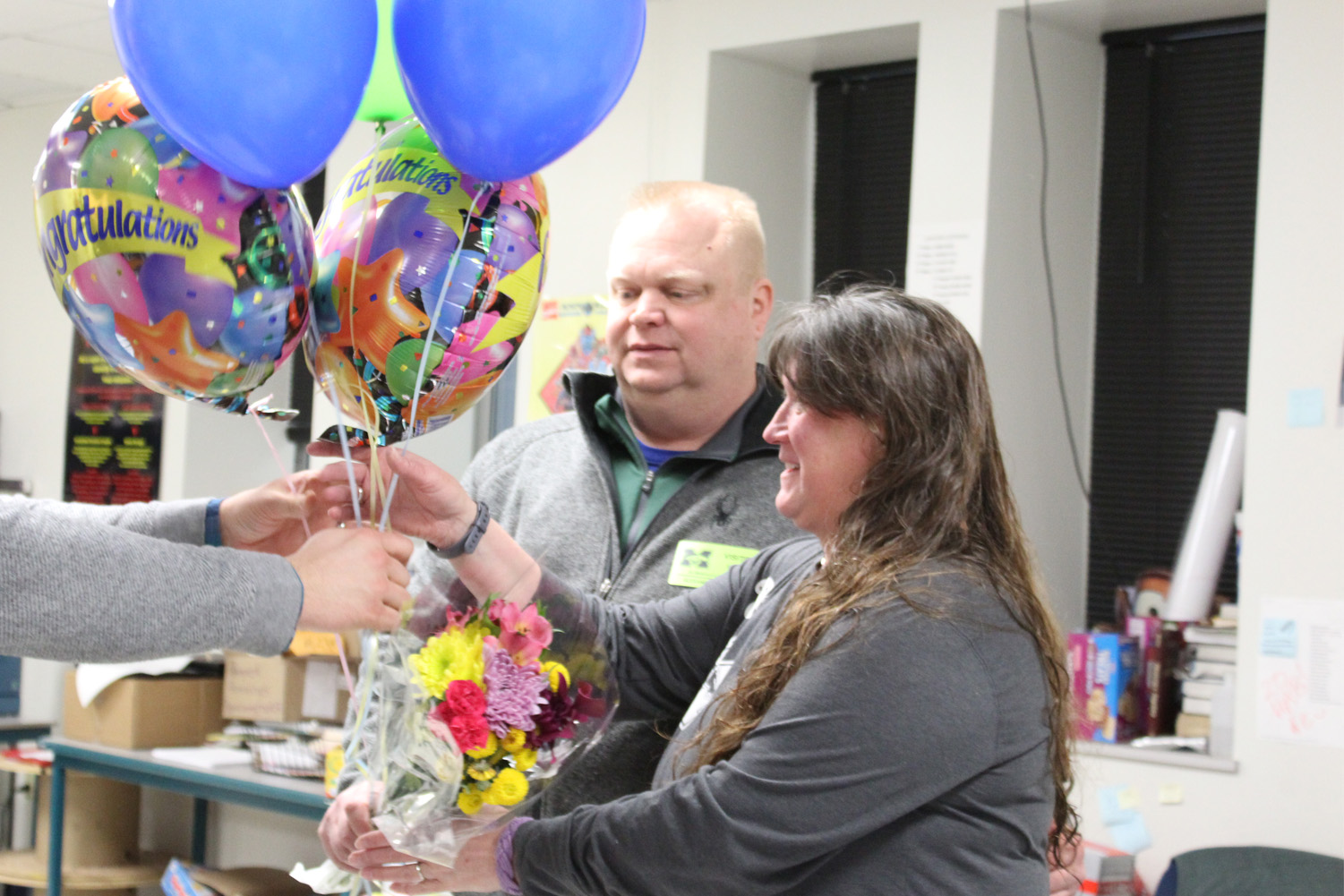 Holly Lehmann, math teacher, receives flowers and balloons on Feb. 20. Lehmann was nominated for and won Teacher of the Year.