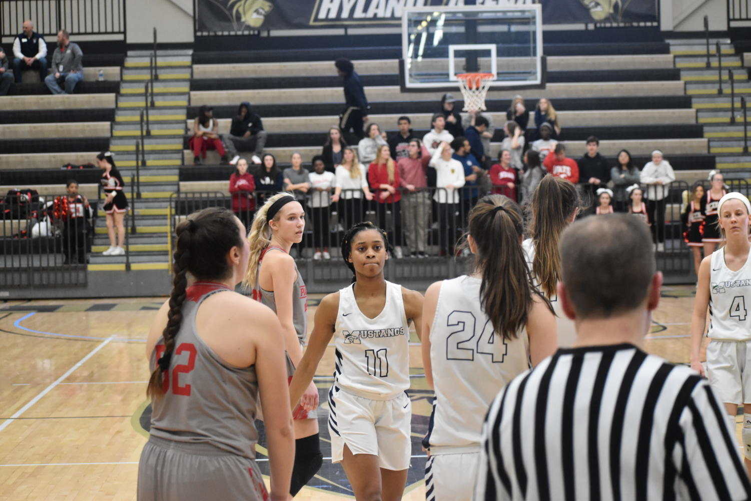 Autumn+Brown%2C+junior%2C+high+fives+her+teammates+after+scoring+a+basket+while+getting+fouled.+Brown+has+been+a+point+guard+for+the+team+since+freshman+year.+%E2%80%9CIt+feels+so+nice+to+score+because+my+teammates+are+so+supportive%2C%E2%80%9D+Brown+said.+