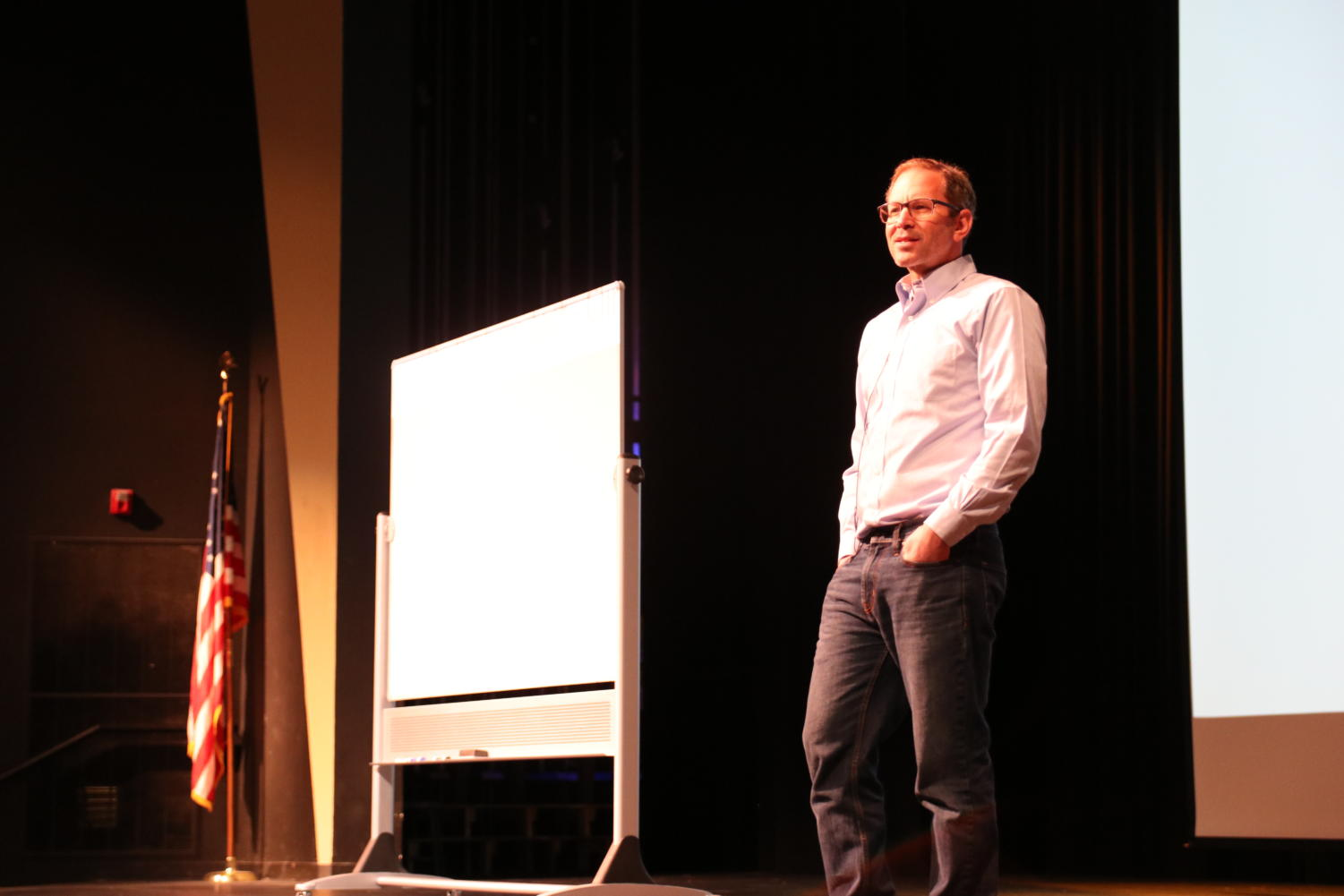 Herzog+begins+his+presentation+after+pulling+a+whiteboard+on+to+the+stage.+He+said+the+event%E2%80%99s+diversity+of+presenters+was+great.+%E2%80%9CHOSA+chose+some+really+great+people+to+come%2C%E2%80%9D+Herzog+said.+%E2%80%9CIt+gave+the+event+a+breath+of+topics+to+hear+about.%E2%80%9D+