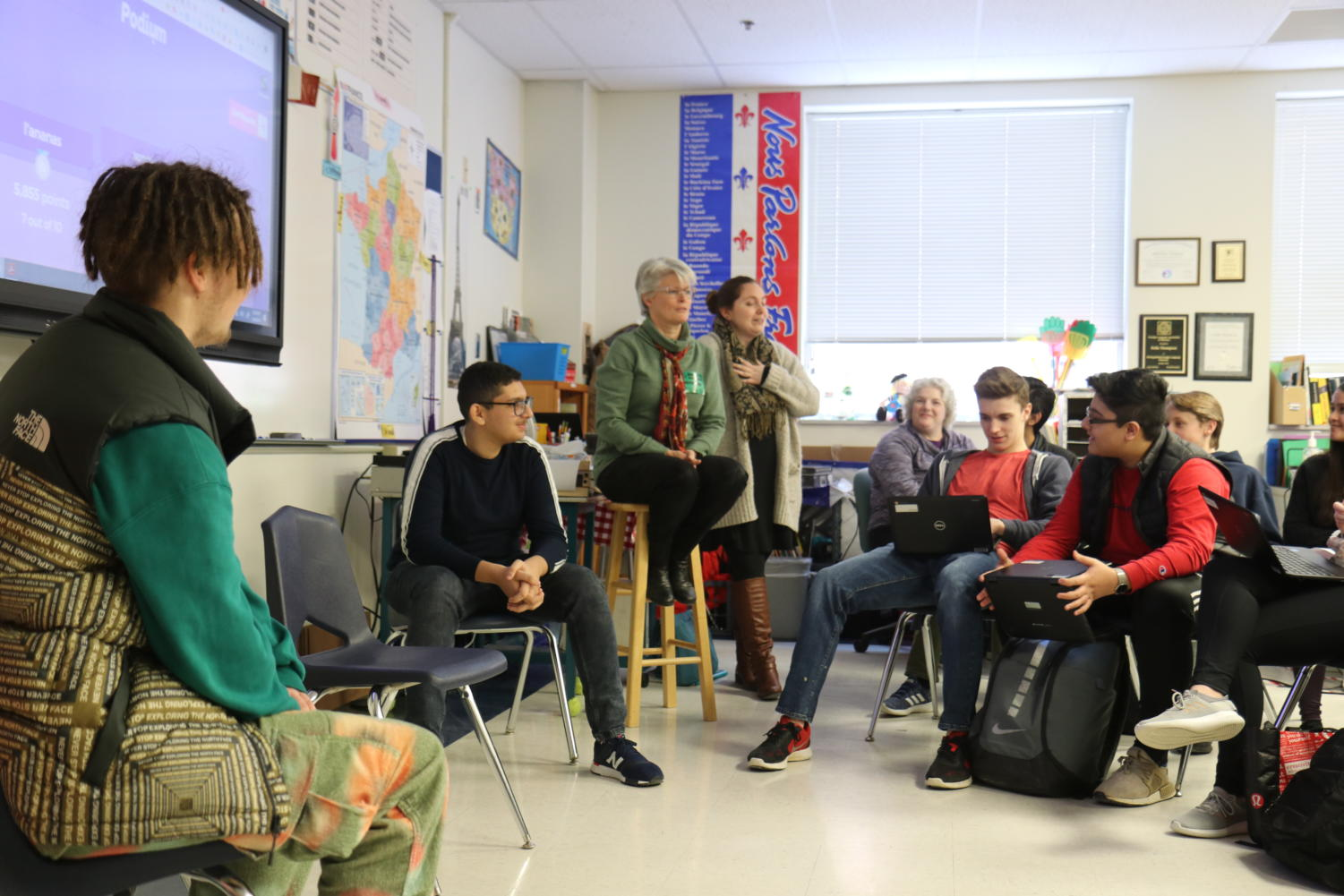 [Left to right]  Quentin Nauge and Salim Saoud, juniors, speak to students in a french class after giving a presentation on on cultural differences between the U.S. and France.