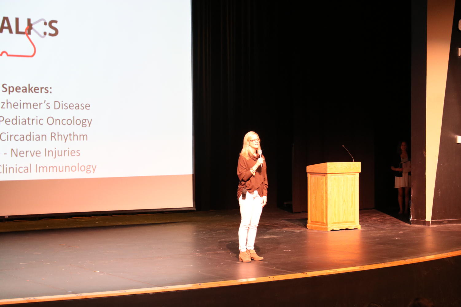 Lisa+Del+Pizzo%2C+AP+Biology+teacher%2C+starts+off+the+Med+Talks+conference+at+MHS+March+2.+She+explained+how+all+proceeds+from+the+event+would+be+going+towards+the+National+Pediatric+Cancer+Foundation.+