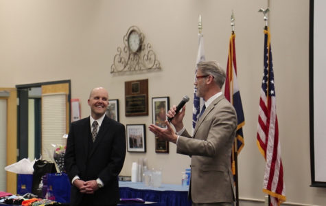 Incoming Superintendent Dr. Mark Miles laughs at a joke told by Superintendent Dr. Eric Knost during a welcome reception held at the RSD Administrative Annex on March 25.