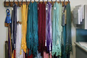 """Seniors are able to apply for honor cords which they will wear at graduation. Each honor cord has criteria that must be met in order to earn it including specifications on the number of classes that must be taken and GPA that must be earned in each discipline. """"Honor cords were designed to award students in particular disciplines in which they have had tremendous success,"""" Laurie Schultz, language arts teacher, said."""