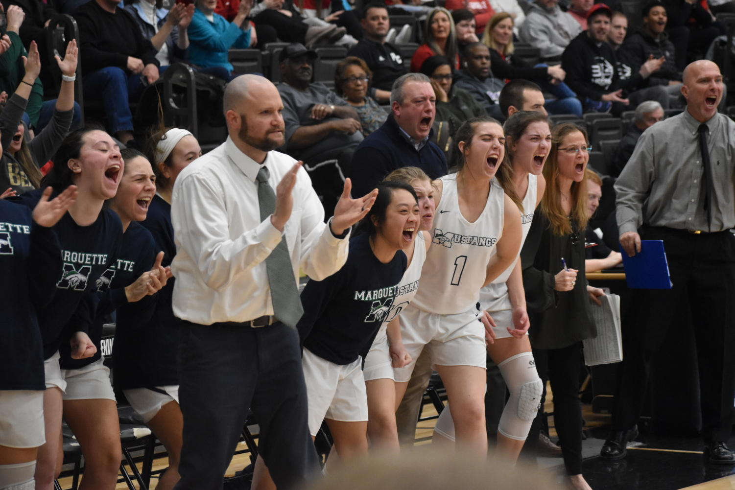 After+Kennedi+Watkins%2C+sophomore%2C+scores%2C+the+bench+erupted+in+cheers.+Watkin%E2%80%99s+basket+put+them+up+by+five+points.+%E2%80%9CThe+bench+is+always+so+hype%2C+especially+when+someone+scores%2C%E2%80%9D+Kaitlyn+Lee%2C+senior%2C+said.+
