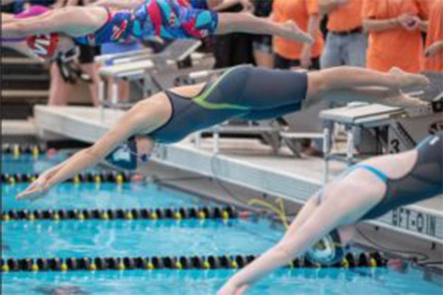 Taryn Zweifel, Senior, dives into the water at the COMO meet at the Mizzou rec center. Zweifel would medal second in the 200 girls medley, the best finish at the meet.