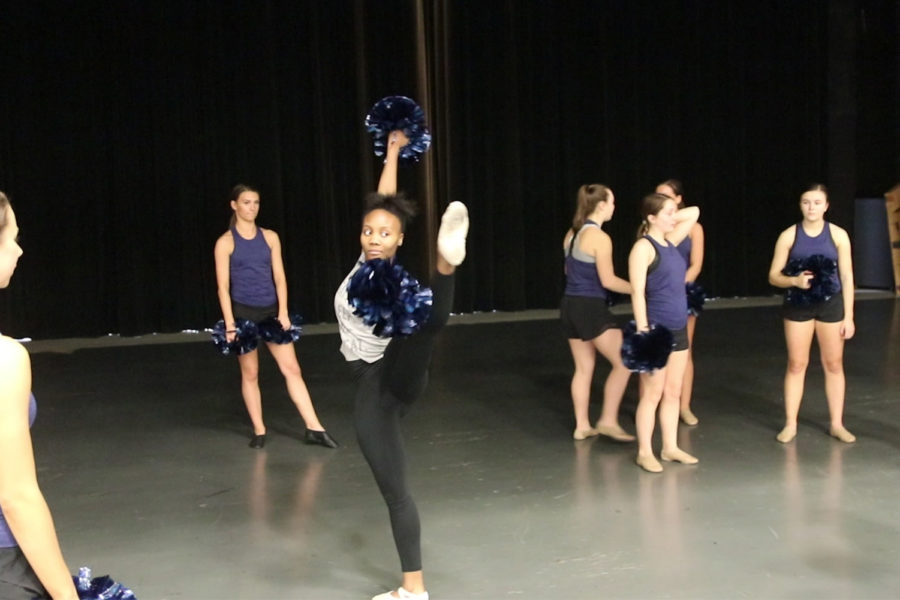 Sam+Hall%2C+sophomore%2C+performs+a+battement+with+poms.+Hall+is+a+ballet+dancer+who+spent+a+day+with+the+MHS+poms+team+to+experience+a+style+of+dance+foreign+to+her.++