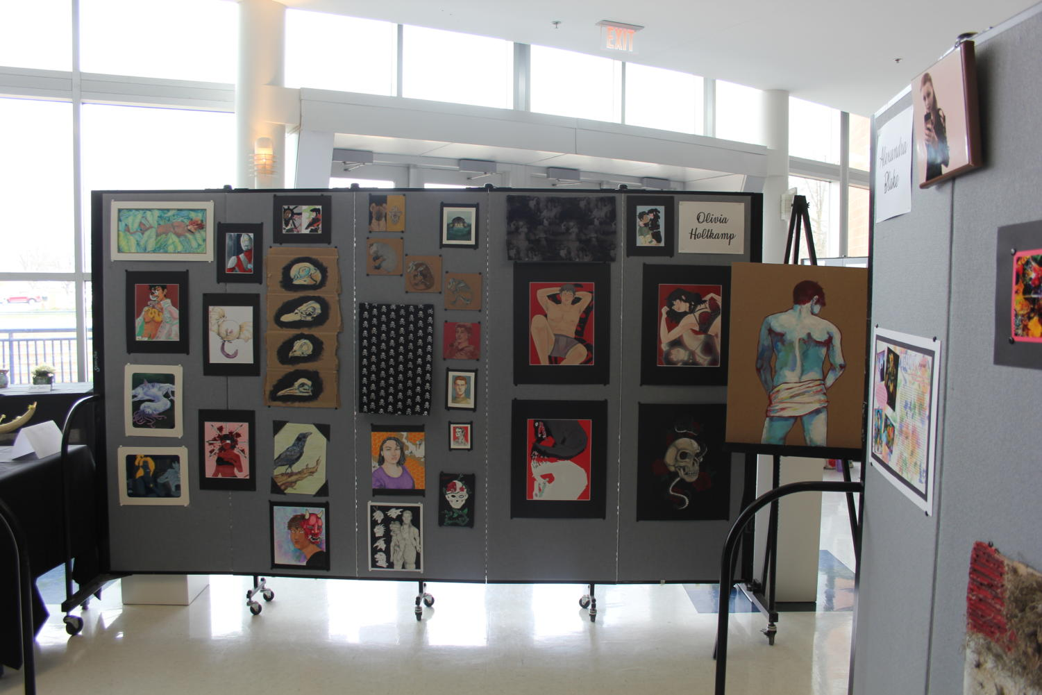 Various+pieces+of+people+and+animals+are+displayed+on+senior+Olivia+Holtkamp%E2%80%99s+board.+%E2%80%9CMy+imagination+just+kind+of+goes+crazy+all+the+time%2C+so+it%E2%80%99s+all+just+a+mix-match+of+crazy+ideas+that+I+have+that+I+want+to+put+somewhere+other+than+my+mind%2C%E2%80%9D+Holtkamp+said.%0A