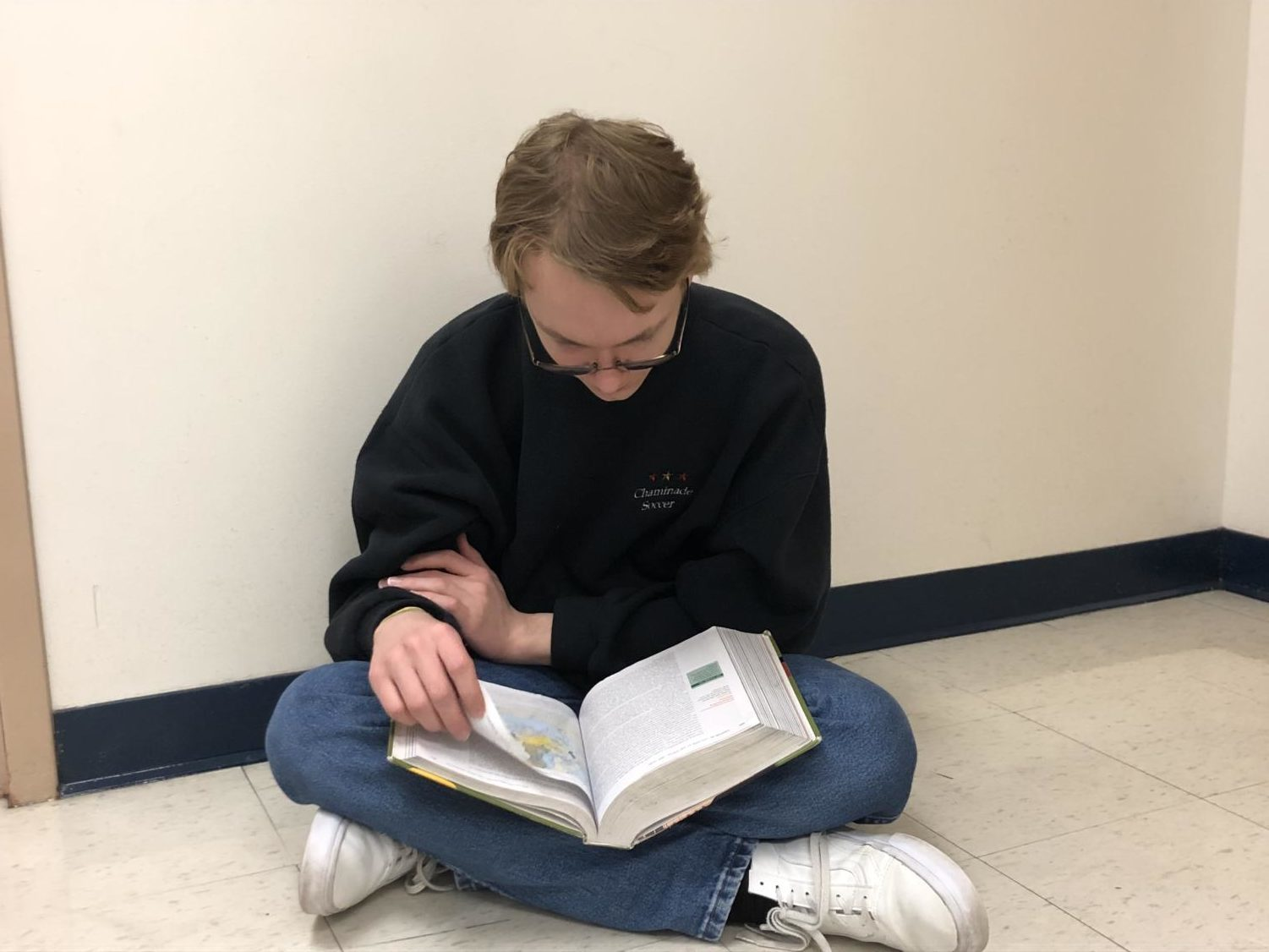 """Grant Hays, sophomore, reads his AP World textbook in preparation for the day's class. Hays said he has about thirty minutes to one hour of homework for AP World a night. """"Keeping up with reading assignments is really important and it makes the class more manageable,"""" Hays said. """"You can always rely on your notes if you ever get behind."""""""
