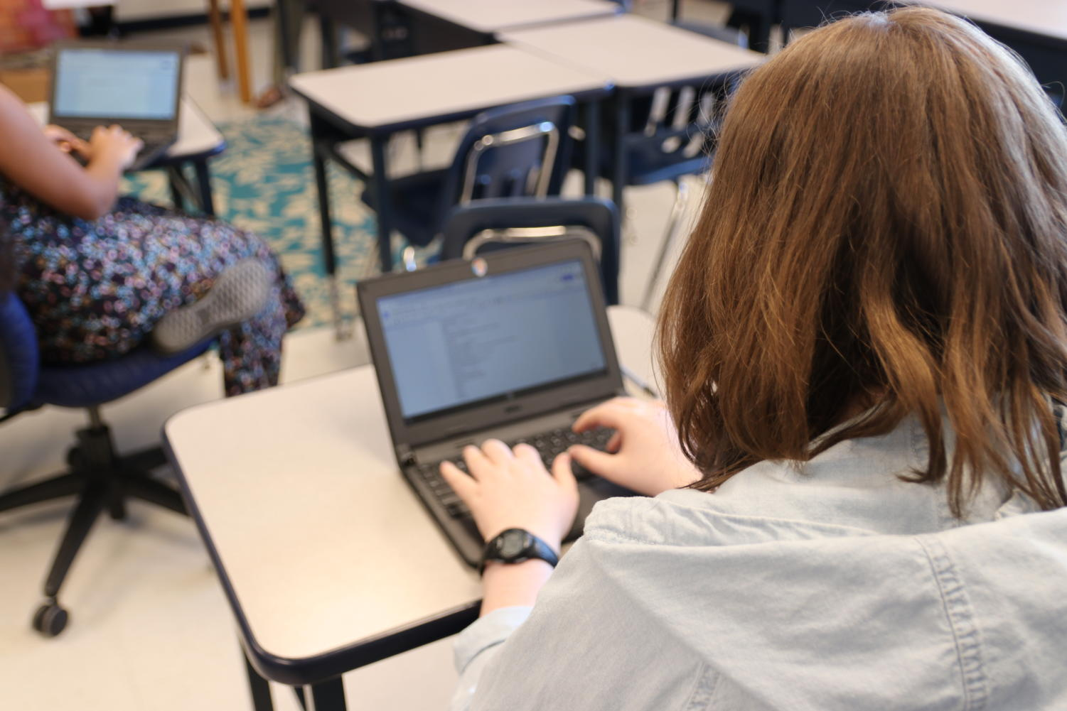 "Molly Millsaps, senior, types a poem on her chromebook for the contest. She is a member of the poetry club and said poetry is sometimes shown in a negative light in schools. ""I hear a lot of teachers say that poetry is complicated and confusing,"" Millsaps said. ""Because of this, students are drawn away from it sometimes."""