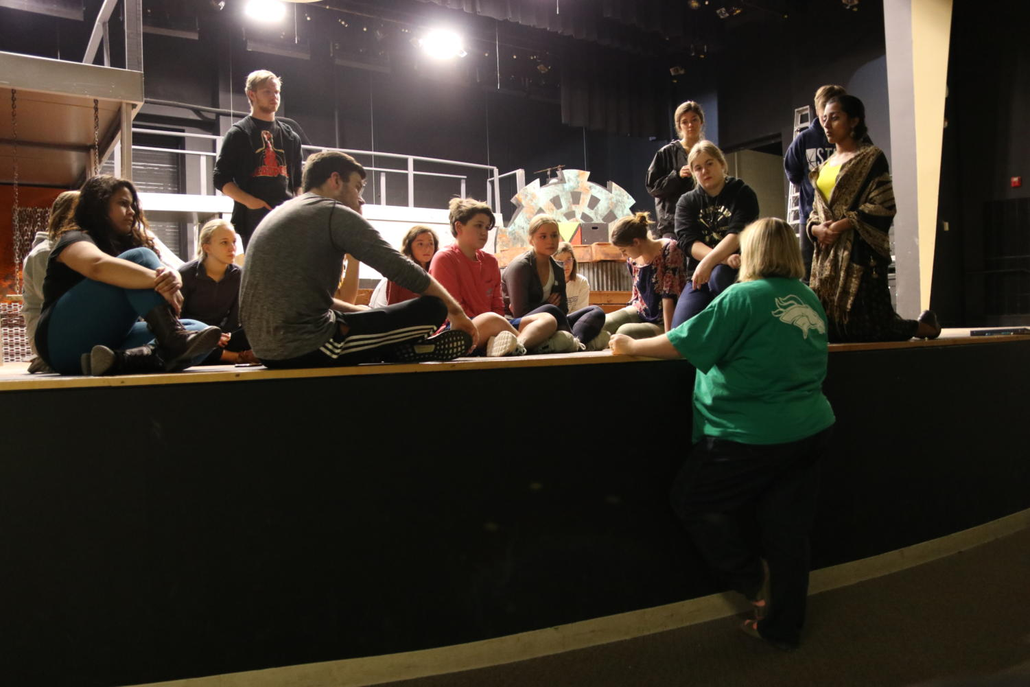 "Rebecca Blindauer, drama and speech teacher, discusses the plan for the practice March 28. The cast primarily worked on refining the play as a whole. ""I think our focus is to take all of the elements we have been working on and try to put them all together,"" Blindauer said."