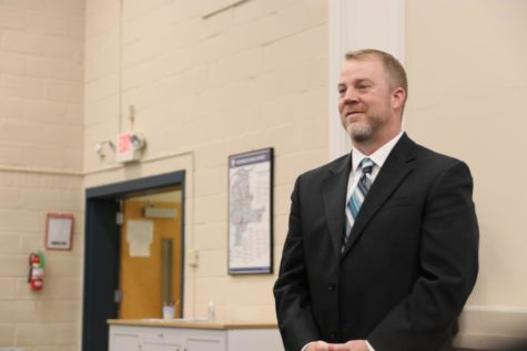 Associate Principal Dr. Steve Hankins stands as Superintendent Dr. Knost recognizes him as the new MHS head principal at the April 11 Board of Education meeting. Dr. Hankins will assume his new position on July 31.