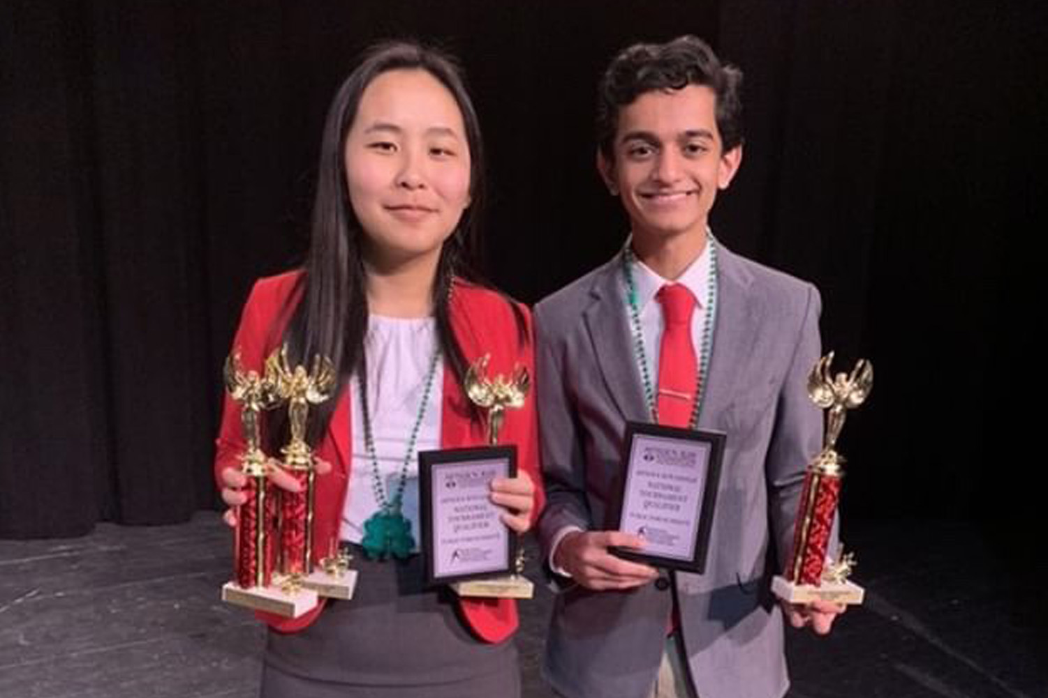 Senior Rachel Pang and freshman Jesh Gandhi pose with their awards after winning first in public forum debate at the Eastern Missouri NSDA Districts Tournament on March 10. This year five MHS students qualified for Nationals, which will be held in Dallas during June 16-21.