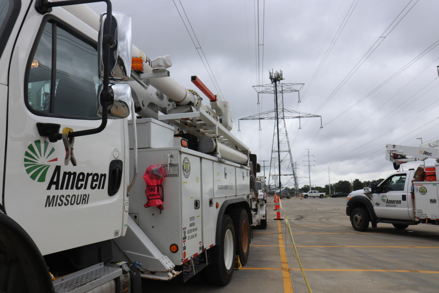 Ameren utility trucks line the MHS parking lot. Twelve trucks and 21 employees were dispatched overnight on Wednesday, Aug. 21, to repair the damaged power lines that run through the property.