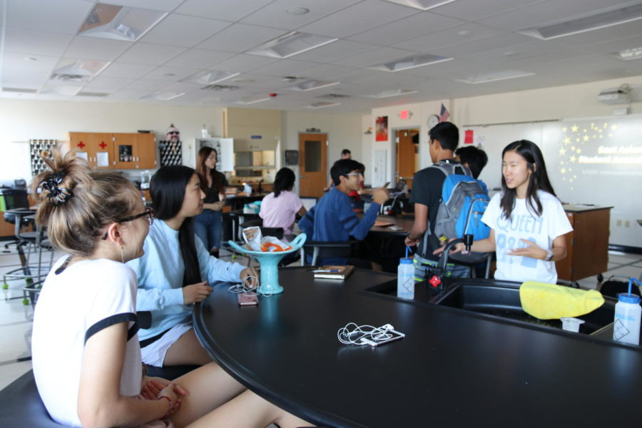 Seniors+Olivia+Coleman+and+Julie+Leung+attend+the+informational+meeting+for+East+Asian+Student+Association.+The+club+was+founded+by+seniors+Ella+Lee+and+Sarena+Yeung.%C2%A0