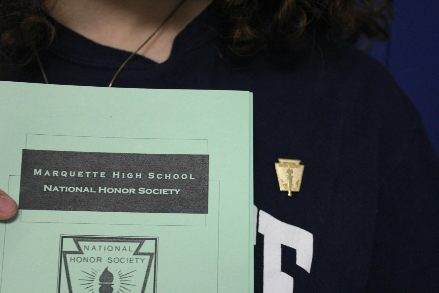 NHS induction ceremony program and pin.