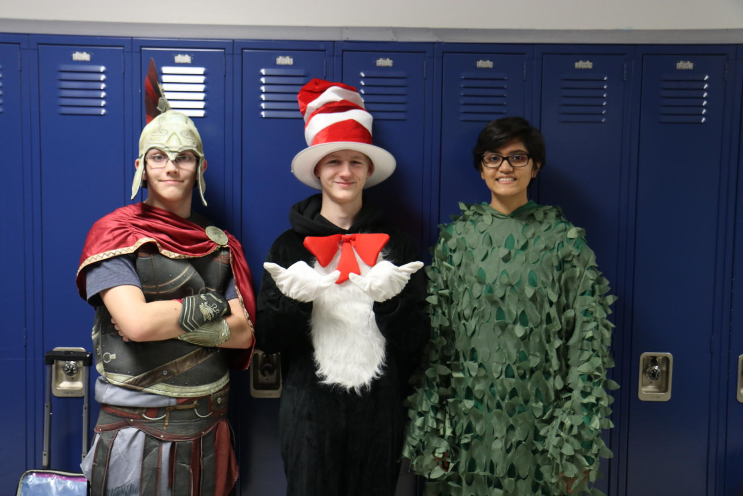 Sophomore+Colbie+Collins+is+dressed+as+a+greek+warrior+with+Mazyn+Green%2C+sophomore%2C+as+Cat+in+the+Hat%2C+and+Sam+Faruq+as+a+bush.